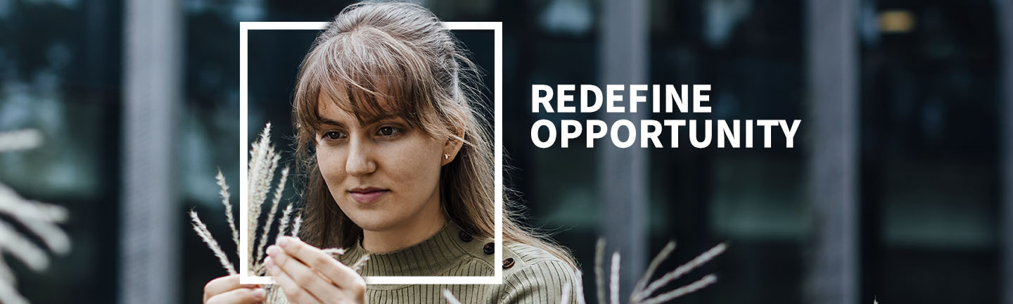 Redefine opportunity with Access Melbourne. Female student examines leaf