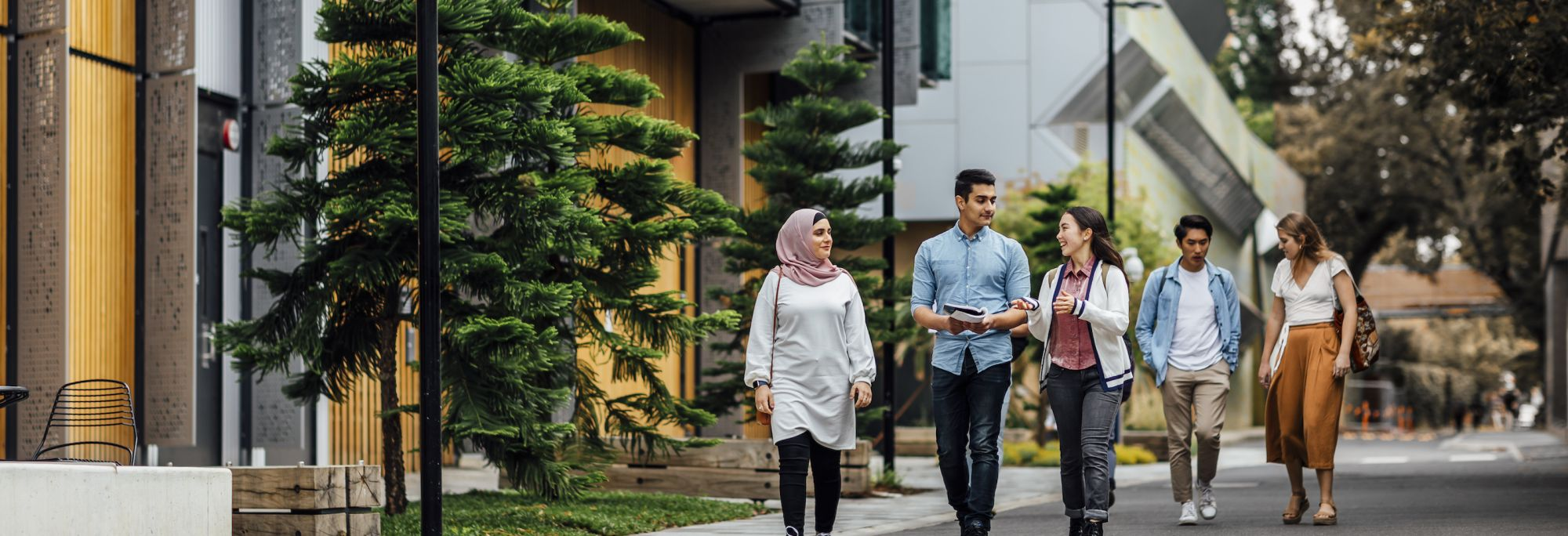 Groups of students walking on Melbourne University campus