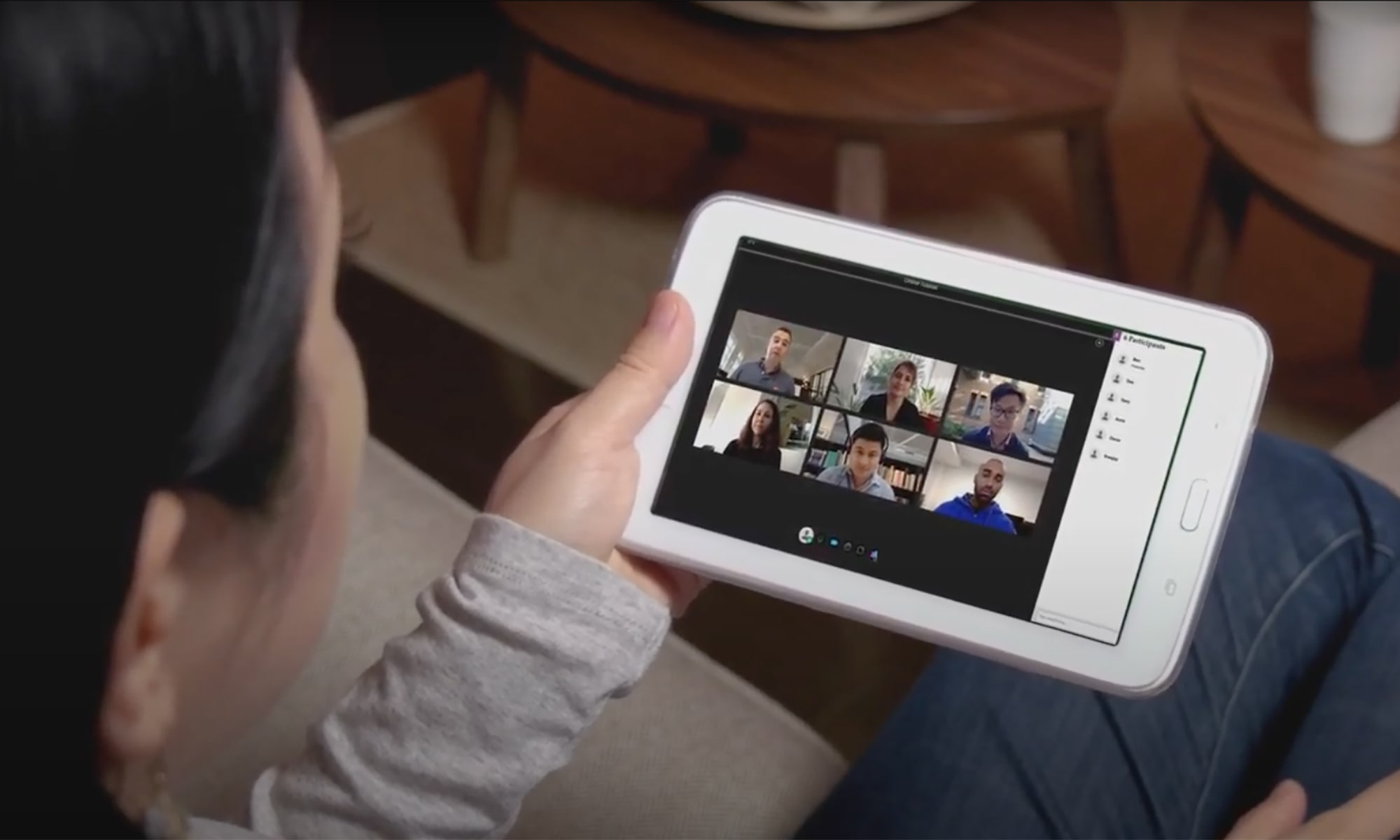 Watching an online meeting on a tablet